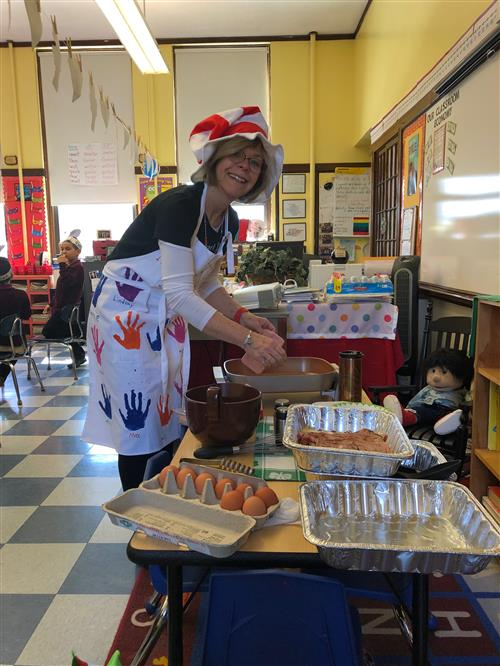 Mrs. Melino celebrates Dr. Seuss' birthday with Green Eggs and Ham